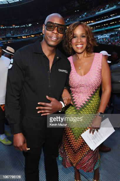 Dave Chappelle and Gayle King pose backstage during the Global Citizen Festival Mandela 100 at FNB Stadium on December 2 2018 in Johannesburg South...
