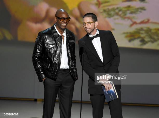 Dave Chappelle and Neal Brennan speak onstage during the 70th Emmy Awards at Microsoft Theater on September 17 2018 in Los Angeles California