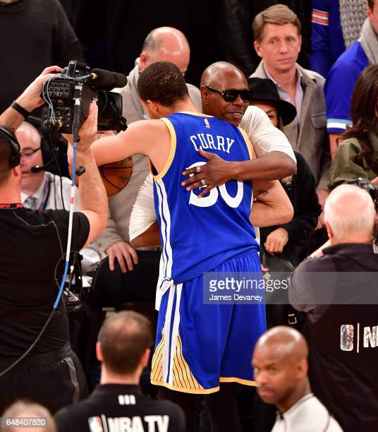 Dave Chappelle and Stephen Curry attend Golden State Warriors Vs New York Knicks game at Madison Square Garden on March 5 2017 in New York City