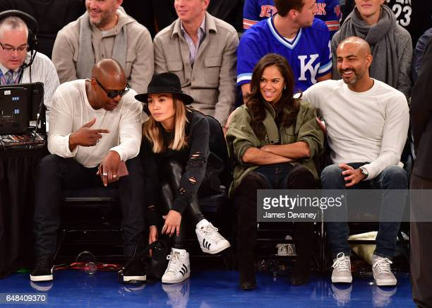 Dave Chappelle Elaine Chappelle Misty Copeland and Olu Evans attend Golden State Warriors Vs New York Knicks game at Madison Square Garden on March 5...
