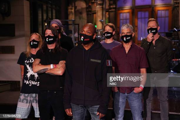 """Dave Chappelle"""" Episode 1791 -- Pictured: Musical guest Foo Fighters with host Dave Chappelle during Promos in Studio 8H on Friday, November 6, 2020..."""