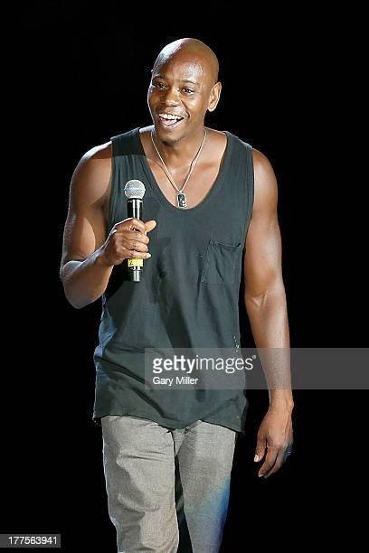 Dave Chappelle performs on stage during the first night of the Oddball Comedy & Curiosity Festival Tour at Austin360 Amphitheater on August 23, 2013...