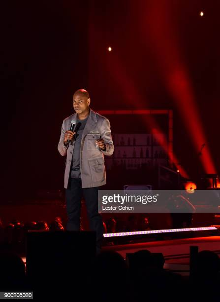 Dave Chappelle performs onstage during Dave Chappelle and John Mayer Controlled Danger at The Forum on December 31 2017 in Inglewood California