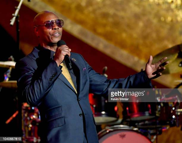 Dave Chappelle speaks onstage at Q85 A Musical Celebration for Quincy Jones at the Microsoft Theatre on September 25 2018 in Los Angeles California