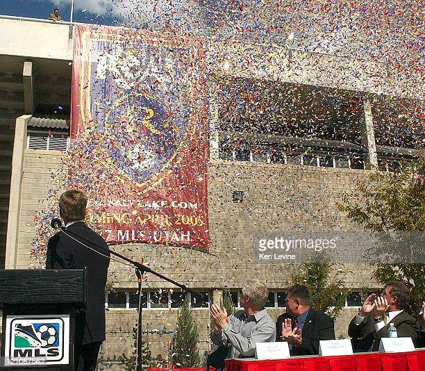Dave Checkitts, the owner of the new MLS expansion soccer team Real Salt Lake, along with others watch as the banner falls and confetti flies at...