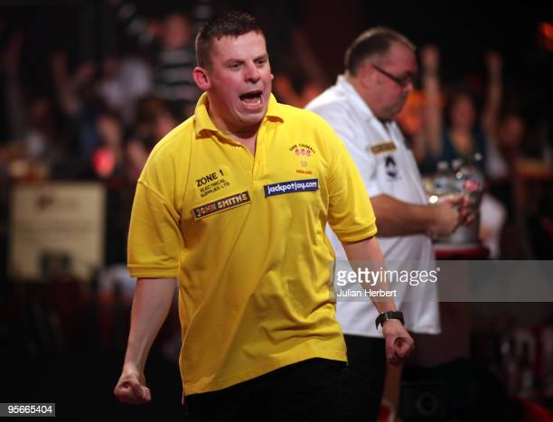 Dave Chisnall of England celebrates beating Tony O' Shea of England during the Semi Final of The World Professional Darts Championship at Lakeside on...