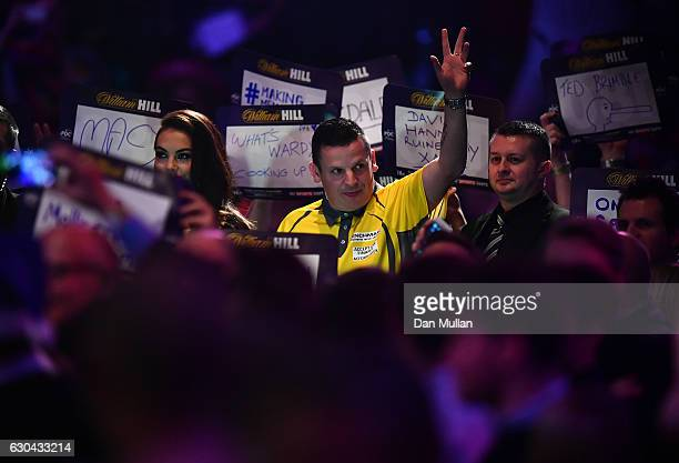 Dave Chisnall of England makes his way to the stage for his first round match against RowbyJohn Rodriguez of Austria on day eight of the 2017 William...