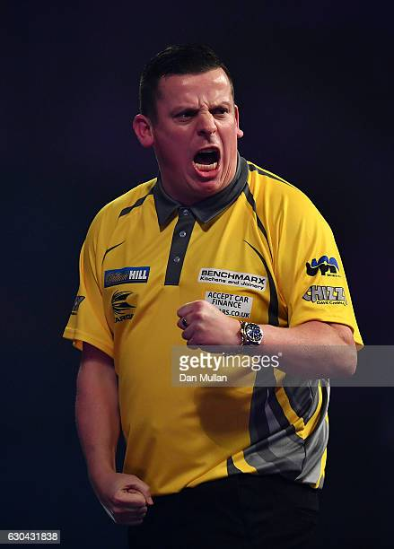 Dave Chisnall of England reacts during his first round match against RowbyJohn Rodriguez of Austria on day eight of the 2017 William Hill PDC World...