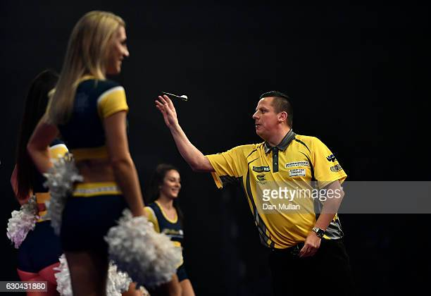 Dave Chisnall of England warms up prior to his first round match against RowbyJohn Rodriguez of Austria on day eight of the 2017 William Hill PDC...