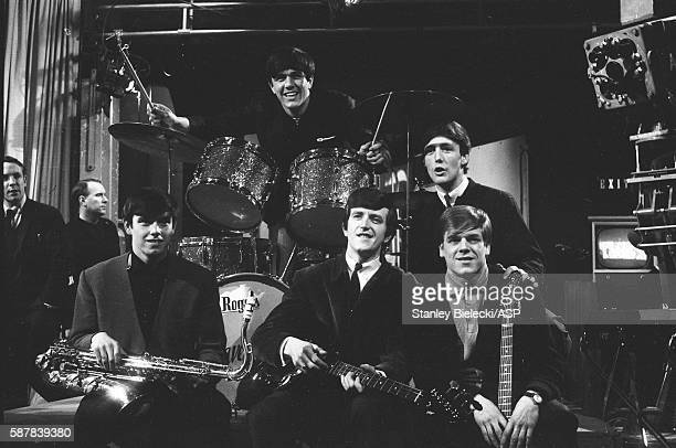 Dave Clark 5 pose for a group portrait on the set of TV show Ready Steady Go Kingsway Studios London February 1964 LR Dave Clark Mike Smith Denis...