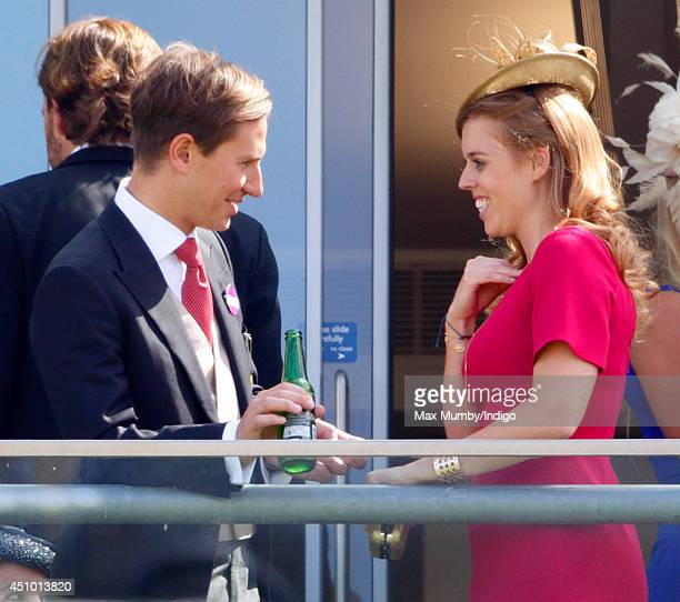 Dave Clark and Princess Beatrice of York watch the racing as they attend Day 5 of Royal Ascot at Ascot Racecourse on June 21 2014 in Ascot England