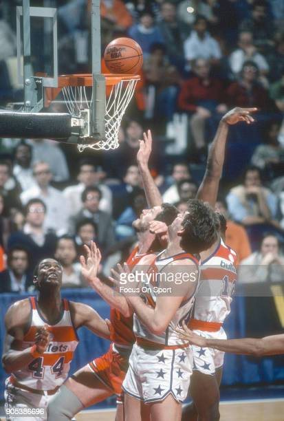Dave Corzine of the Chicago Bulls battles for a rebound with Carlos Terry and Jeff Ruland of the Washington Bullets during an NBA basketball game...
