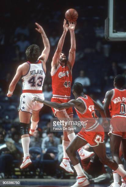 Dave Corzine of the Chicago Bulls goes up for a rebound over Jeff Ruland of the Washington Bullets during an NBA basketball game circa 1983 at the...