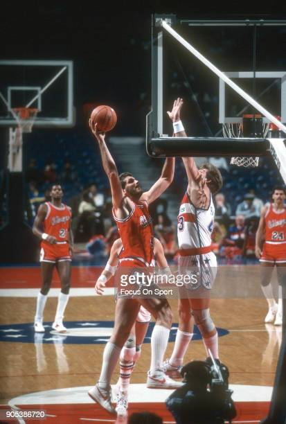 Dave Corzine of the Chicago Bulls goes up to to shoot over Jeff Ruland of the Washington Bullets during an NBA basketball game circa 1983 at the...