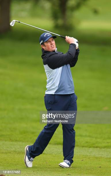 Dave Coupland of England plays his second shot on the first hole during the final round of The Betfred British Masters hosted by Danny Willett at The...