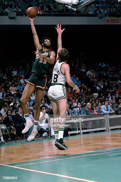 Dave Cowens of the Boston Celtics defends against Kareem AbdulJabbar of the Milwaukee Bucks during an NBA game circa 19701975 at the Boston Garden in...