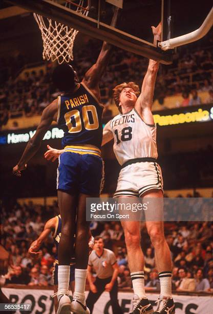 Dave Cowens of the Boston Celtics jumps for the rebound with Robert Parish of the Golden State Warriors during a game at the Boston Gardens circa...