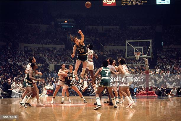 Dave Cowens of the Boston Celtics wins the jump ball against Willis Reed of the New York Knicks during the Eastern Conference Finals played in 1973...