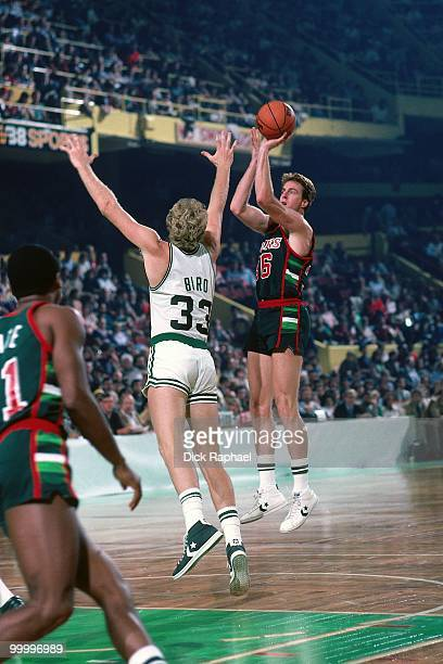 Dave Cowens of the Milwaukee Bucks shoots a jump shot against Larry Bird of the Boston Celtics during a game played in 1983 at the Boston Garden in...