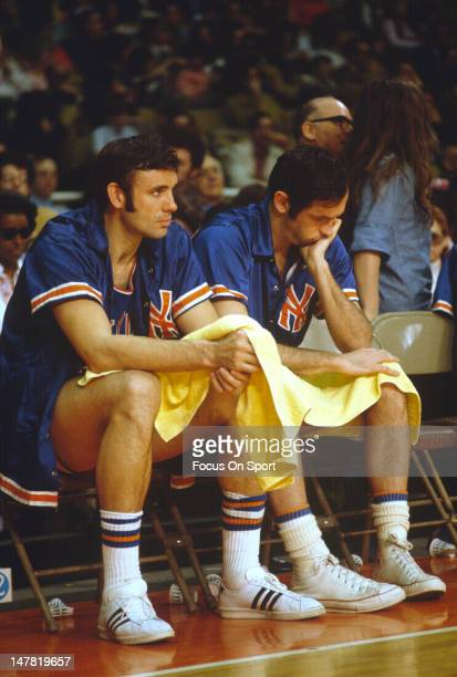 Dave DeBusschere and Bill Bradley of the New York Knicks looks on from the bench against the Washington Bullets circa 1974 at the Capital Centre in...