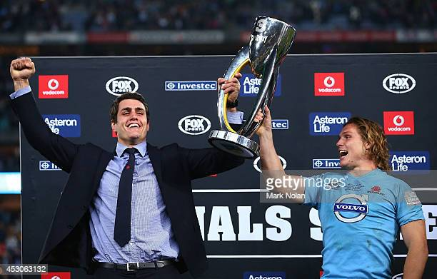 Dave Dennis and Michael Hooper of the Waratahs hold the trophy after winning the Super Rugby Grand Final match between the Waratahs and the Crusaders...
