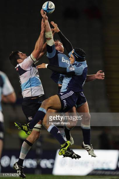 Dave Dennis of the Waratahs competes with Luke Braid and Winston Stanley of the Blues in the air for the ball during the Super Rugby qualifier match...