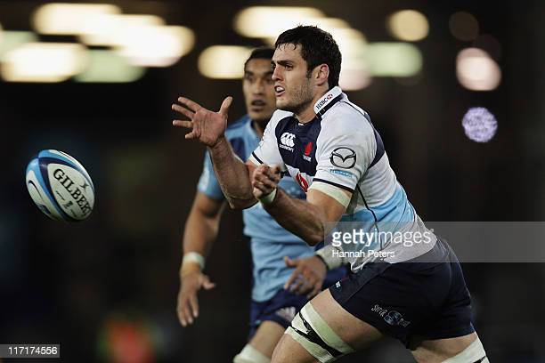 Dave Dennis of the Waratahs passes the ball out during the Super Rugby qualifier match between the Blues and the Waratahs at Eden Park on June 24...