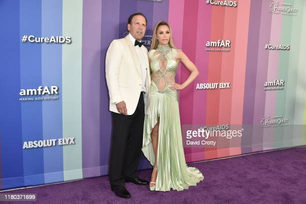 Dave Dollinger and Tara Dollinger attend the 2019 amFAR Gala Los Angeles at Milk Studios on October 10 2019 in Los Angeles California