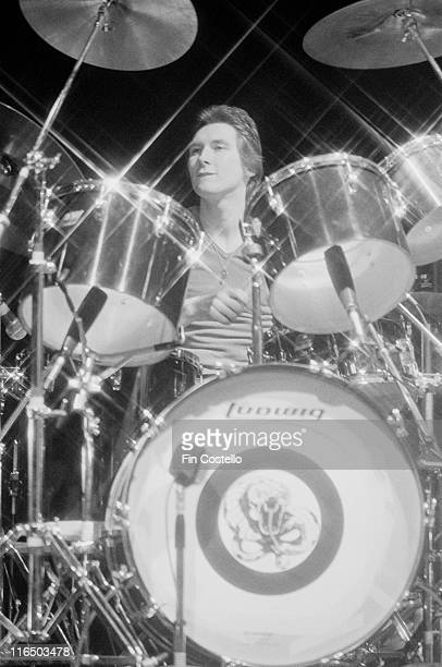 Dave Dowle British drummer with heavy rock band Whitesnake playing the drums on stage during a video shoot at Shepperton Studios outside London...