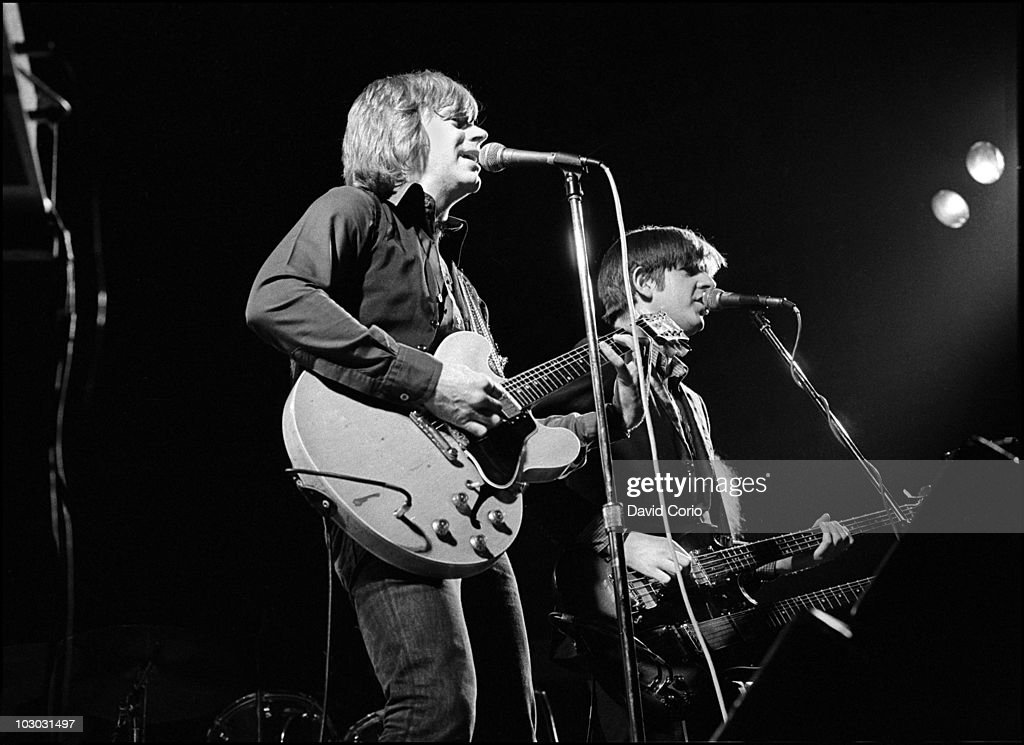 Dave Edmunds and Nick Lowe perform on stage at Birmingham Town Hall on 25 October 1977 in Birmingham, UK.