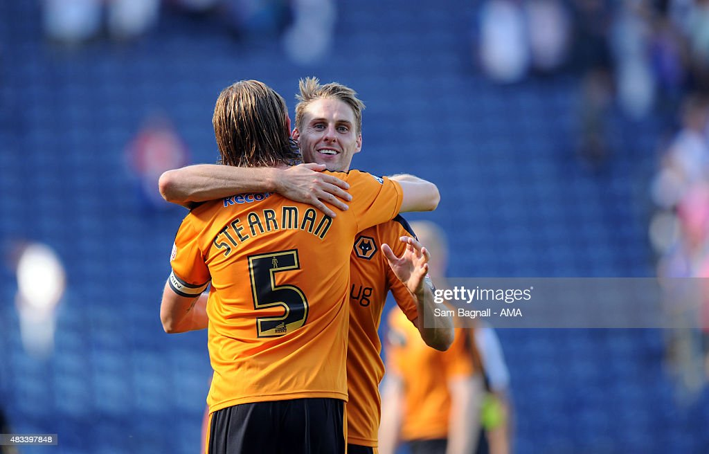 Dave Edwards of Wolverhampton Wanderers and Richard Stearman of Wolverhampton Wanderers celebrate at full time after the Sky Bet Championship match between Blackburn Rovers and Wolverhampton Wandereres at Ewood park on August 8, 2015 in Blackburn, England.