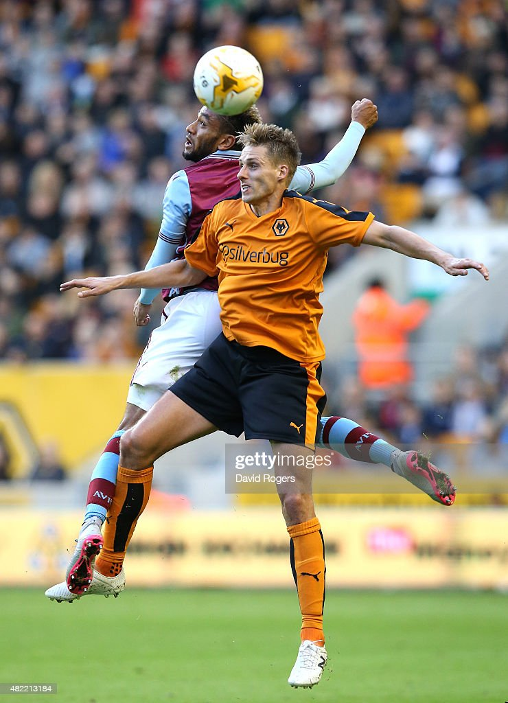 Dave Edwards of Wolves is challenged by Jordan Amavi during the pre season friendly match between Wolverhampton Wanderers and Aston Villa at Molineux on July 28, 2015 in Wolverhampton, England.