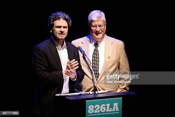 Dave Eggers and Louis Lucido speak onstage during 826LA's Tell Me A Story at The Wiltern on June 2 2016 in Los Angeles California