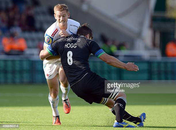 Dave Ewers of Exeter Chiefs tackled by Ally Hogg of Newcastle Falcons ahead of the Aviva Premiership match between Newcastle Falcons and Exeter...