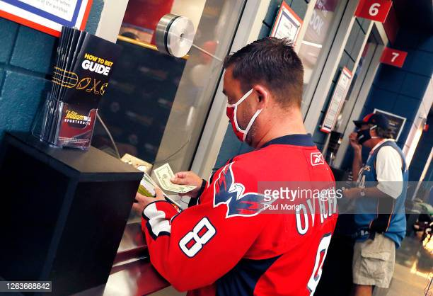 Dave Feldman places a bet as William Hill officially opened its first-ever sports book within a U.S. Sports complex at Capital One Arena in...