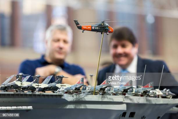 Dave Fortey and Stephen Metcalfe MP the new 2018 Government Envoy for the Year of Engineering look at details on Mr Fortey's model of HMS Ark Royal...