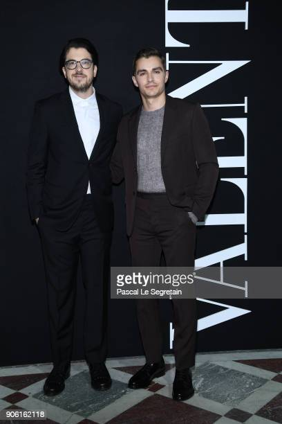 Dave Franco and a guest attend the Valentino Menswear Fall/Winter 20182019 show as part of Paris Fashion Week on January 17 2018 in Paris France
