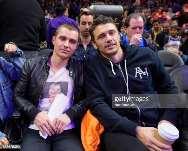 Dave Franco and James Franco attend a basketball game between the Golden State Warriors and Los Angeles Clippers at Staples Center on February 2 2017...