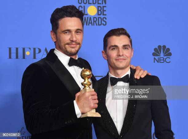 Dave Franco poses with James Franco and his trophy for Best Performance by an Actor in a Motion Picture Musical or Comedy during the 75th Golden...