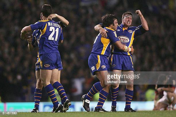 Dave Furner of Leeds celebrates with Willie Poching after his side's 168 victory during the Tetley's Super League Grand Final match between Bradford...