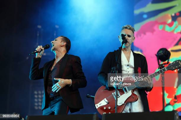 Dave Gahan and Martin Gore of Depeche Mode perform on stage with his band during Arras' Main Square festival day 2 on July 7 2018 in Arras France