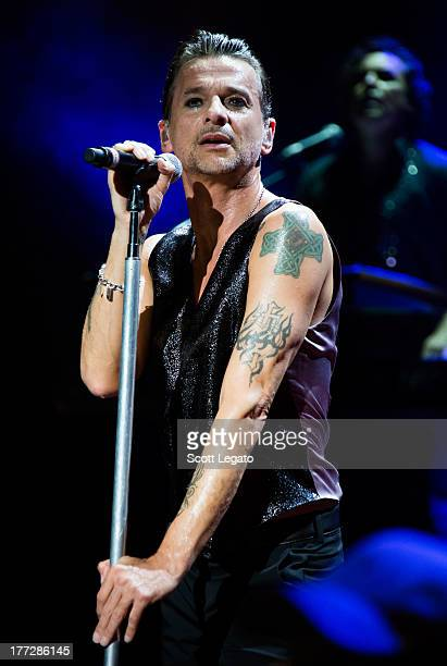 Dave Gahan of Depeche Mode performs during their tour opener in support of The Delta Machine Tour at the DTE Energy Music Theater on August 22, 2013...