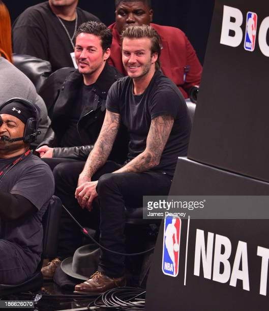 Dave Gardner and David Beckham attend the Miami Heat vs Brooklyn Nets game at Barclays Center on November 1 2013 in the Brooklyn borough of New York...