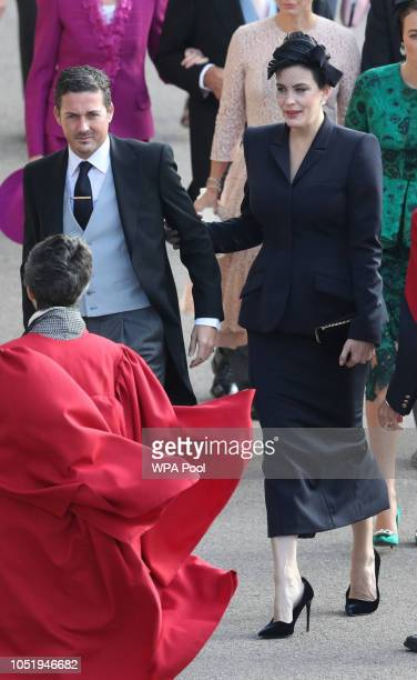 Dave Gardner and Liv Tyler arrive ahead of the wedding of Princess Eugenie of York and Mr Jack Brooksbank at St George's Chapel on October 12 2018 in...