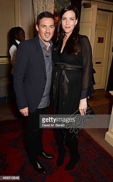 Dave Gardner and Liv Tyler attend a party hosted by David Beckham and Alister Mackie to celebrate Another Man Magazine at Mark's Club on November 20...