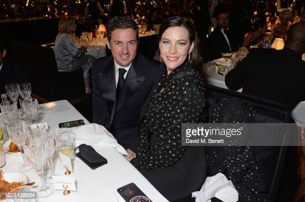 Dave Gardner and Liv Tyler attend The Fashion Awards 2018 in partnership with Swarovski at the Royal Albert Hall on December 10 2018 in London England