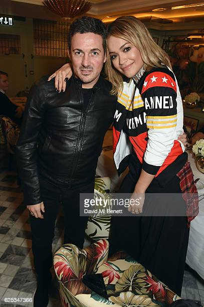 Dave Gardner and Rita Ora attend the adidas Originals by Rita Ora dinner at The Ivy Chelsea Garden on November 23 2016 in London England