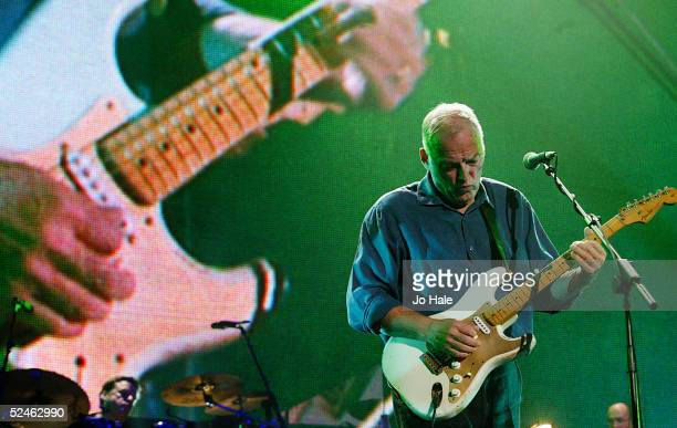 Dave Gilmour of Pink Floyd performs on stage as part of The Miller Strat Pack concert at Wembley Arena on September 24 2004 in London The event pays...