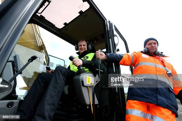 Dave Goosselink of Dunedin poses for a photo with his instructor at Dig This on October 2 2017 in Invercargill New Zealand Guests are given the...