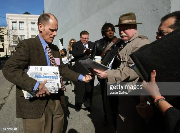 Dave Grealish hands out registration forms to job seekers as they wait in line to enter the California Job Journal HIREvent February 10 2009 in San...